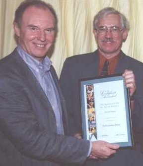Tim Piggot Smith presents Roger Cornwell with his sponsor's certificate